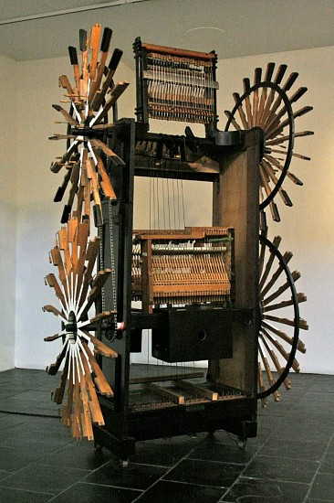 LYNETTE BESTER, Le Marteau Sans Maitre (Hammer Without Master) 2007, One Stand up Piano, Two Wind-Screen Wiper Motors, Bicycle Cogs and Chains